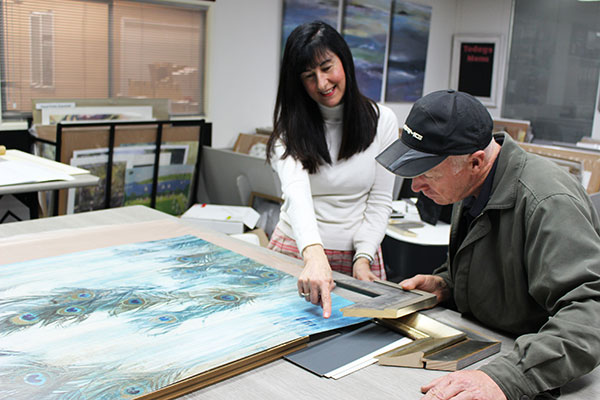 Selecting a board and frame for art with a client